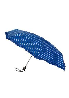 Bright blue polka dot umbrella is cheerful for a rainy day.
