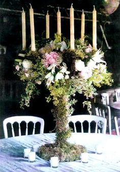 I love this table centerpiece! The candelabra looks so woodsy and enchanted!!