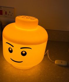 Animate your kid's bedroom with some quaint ambient lighting provided by this LED LEGO head lamp. Made from polypropelene, it is fitted with a LED bulb that emits a warm yellow glow that's as inviting as its joyful smile. Lego Bedroom, Kids Bedroom, Boy Bedrooms, Bedroom Furniture, Furniture Ideas, Legos, Lego Room Decor, Casa Lego, Bedroom Decor