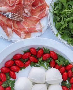 Italian lunch with mozzarella, tomatoes and prosciutto.