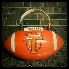 ☆SOLD ☆          UT VOLS TENNESSEE FOOTBALL Vintage UT BIG ORANGE TENNESSEE VOLS FOOTBALL SHAPED PURSE/LUNCHBAG. Also looks great as FOOTBALL TIME IN TENNESSEE Home Decor/TailGating Centerpiece. Hard Plastic with Plastic/Metal Handle & Leather/Metal Closure Other