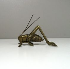 DESCRIPTION: This listing is for a small brass cricket figurine. Its a small size, measuring just 3.75 long. In good condition, but the antennae are