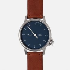 M24 STAINLESS-STEEL/NAVY WATCH ON BROWN LEATHER STRAP   MIANSAI