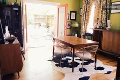 Airbnb Room available for Richmond, VA   Open dining room (table can seat up to 6 people) with mid century bar & French doors that open to a side porch.