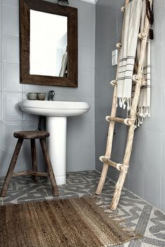 Driftwood ladder for hanging towels...