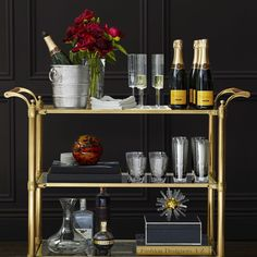 We asked @lemonstripes to share her tips on decorating a party-ready bar cart! Follow the link in our profile to learn how she makes the spirits bright, literally. ✨