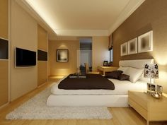 Large+light+brown+bedroom+with+white+rug+and+bed,+light+wood+furniture+and+floor+with+tray+ceiling