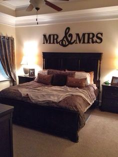 Master Bedroom idea. not the mr and mrs but love the black furniture with brown accents
