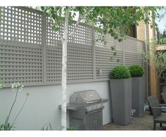 Trellis garden panels and planters in a soft greige