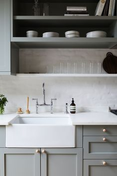 The kitchen cabinets are from Ikea, with cabinet fronts from Semihandmade painted in Farrow & Ball's Pigeon. The Perrin & Rowe Bridge Kitchen Faucet with Sidespray is from Rohl (for more ideas, go to 10 Easy Pieces: Architects' Go-To Traditional Kitchen Faucets). And for the rundown on our favorite farmhouse sinks, go to 10 Easy Pieces: White Kitchen Farmhouse Sinks.