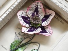 UK artist Kate Kato creates beautiful little sculptures using found and recycled materials and inspired by the botanical world. Each delicate plant or insect sculpture she makes is unique, so no two artworks. Recycled Crafts, Recycled Materials, Book Sculpture, Sculptures, Different Types Of Fabric, Butterfly Decorations, Mini Things, Paper Artist, Handmade Design