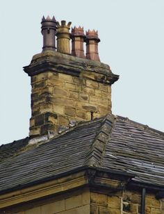Chimney Pots atop old Manor houses in England | of chimney pots as being solely British. In reality, chimney pots ...