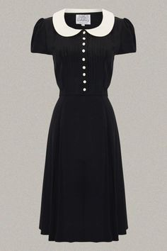 http://www.rocknromance.co.uk/store/p47/Dorothy_Dress_in_Black_with_White_Collar.html