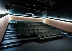 Timber-clad cinema in France by Encore Heureux inspired by art deco picture houses and the chevron-patterned walls of tobacco-drying sheds Cinema Theatre, Cinema Room, Acustic Panels, White Wooden Chairs, Theater Architecture, Wooden Dining Room Chairs, Mall Design, Hall Interior, Home Theater Rooms
