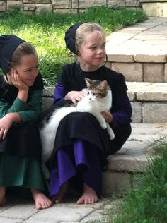 """Yup, definitely the girls on my book series """"adventures of lily Lapp"""" (the one in green Is lily and the purple is her cousin Hannah"""""""