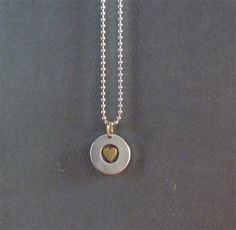 gold and silver heart charm necklace by raeandco on Etsy, $76.00