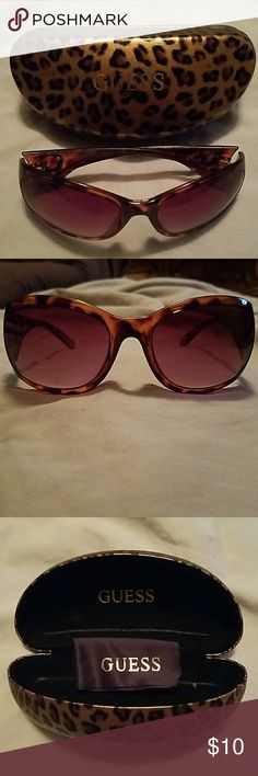 GUESS TORTOISE SHELL SUNGLASSES GUESS TORTOISE SHELL SUNGLASSES.  These have been worn but are in excellent condition.  No scratches on the lenses. Guess Accessories Glasses