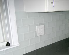 Frosted glass subway tile backsplash                                                                                                                                                                                 More