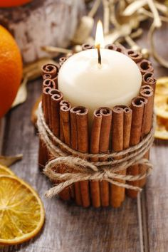 Cinnamon stick candle holder DIY project: use hot glue to attach the cinnamon sticks and wrap in garden twine.  This is one of the ideas for fabulous fall projects from nature. There are ideas for crafts made with leaves, acorns, pine cones, and more.