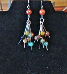 Copper, glass beads.
