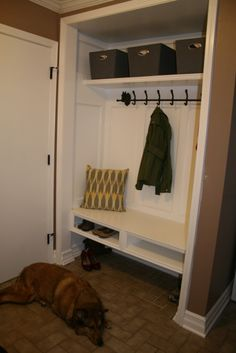 Closet converted Mudroom--open space below is perfect for snow covered shoes during winter just add shoe rug/tray to collect the water! Great idea for our garage entry