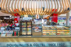 The Krispy Kreme kiosk was designed to be enhanced by the mall timber features and not limited by them.   #Design #InteriorDesign #HospitalityDesign #SouthAfrica #Architecture #DesignThatWorks #DesignforEveryone #foodandbeverage #ExperienceDesign #DesignPartnership #RestaurantDesign #DesignPhotography #DesignInspiration #ConceptualDesign