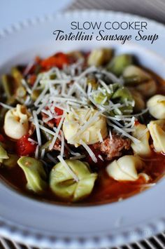 Delicious Slow Cooker Tortellini Sausage Soup - a favorite slow cooker meal in our house.  Must try!