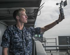 PACIFIC OCEAN (July 13, 2014) Aerographer's Mate Airman Nathan Bruce takes weather samples using a handheld anemometer on board the aircraft carrier USS Nimitz (CVN 68). Nimitz is currently underway performing routine operations and training exercises. (U.S. Navy photo by Mass Communication Specialist 3rd Class Kelly M. Agee/Released)