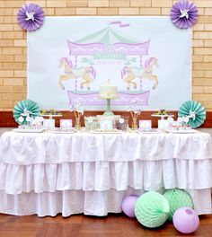 TABLE SETUP: Girly, soft colors, definitely not your traditional carnival. I love the pinwheels in the middle of the medallions and the ruffle skirt