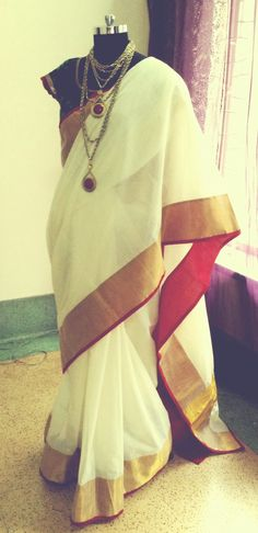 I want this white saree by Ayush Kejriwal. I would put my hair in a messy high bun, rock big earrings and smoky eyes.