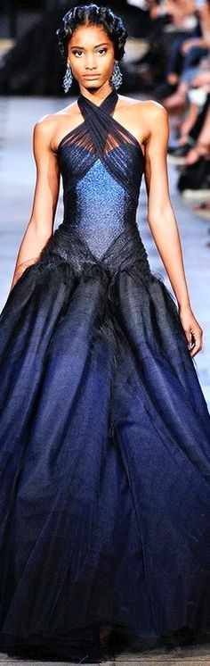 Zac Posen. I LOVE the top; if they had extended it to the bottom it would have been even prettier.