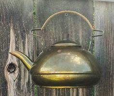 Brass and Wicker Teapot Wind Chime. I search the nation to find unique items just waiting to be rejuvenated! My mission is to preserve and upcycle discarded treasures. I lovingly create every piece by hand in the hopes that others can enjoy them for years to come. This lovely little brass teapot has been upcycled into a wind chime. The handle highlights the teapot with it's unique shape and wicker wrapping. Seven antique silver-plated spoons hang from the bottom of the teapot. Each line...