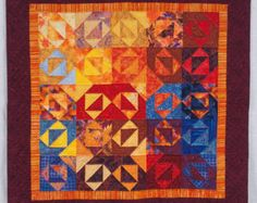 Wondering.  How does one make a red/blue quilt palette -- without going patriotic?  Example on etsy of red and yellow quilt.