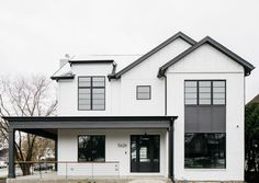 This black and white themed home is the perfect place for you to gather inspiration for your own home remodel! Find paint names and products inside! Black Windows Exterior, White Exterior Houses, White Siding, Modern Farmhouse Exterior, White Houses, Exterior Paint, Dark House, House 2, Board And Batten Exterior