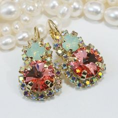 Items similar to Mint Coral Earrings Peach Green Swarovski Statement Crystal Earrings AB Drop Halo Earrings,Swarovski rhinestones Crystals Gold finish, on Etsy Coral Earrings, Crystal Earrings, Crystal Rhinestone, Swarovski Crystals, Drop Earrings, Halo, Mint Coral, Peach And Green, Matching Necklaces