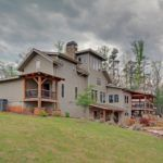 Rear of Timber Frame Home with Multiple Porches - Houses - Exterior - Timber Frame HQ - http://timberframehq.com/timberframephotos/houses-exterior/?utm_content=bufferc0d3f&utm_medium=social&utm_source=pinterest.com&utm_campaign=buffer