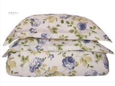 The Ambra luxury printed sateen duvet cover set was inspired by a floral pattern of collective shades of blue & green leaves on white fabric. 100% long-staple Egyptian Cotton sateen, 310 Thread Count. Smooth, soft & subtle shine.   Fabric designed and woven in Italy.  Duvet set includes 1 duvet cover & 2 pillow shams Satisfaction guaranteed Duvet Sets, Duvet Cover Sets, Egyptian Cotton, Beige Color, Light Beige, White Fabrics, Green Leaves, Luxury Bedding, Pillow Shams