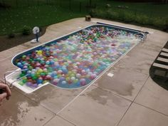 Water balloon filled pool. this needs to be done