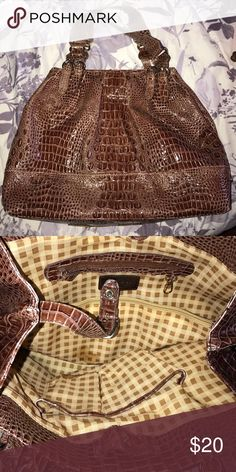 Jessica Simpson brown purse Jessica Simpson brown purse. Lightly used but in great condition. Jessica Simpson Bags Hobos