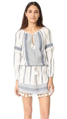 Intricate patterning and small tassels accent this Saylor dress. Inset drawstrings at the waist and neckline. Long sleeves and gathered elastic cuffs. Unlined.