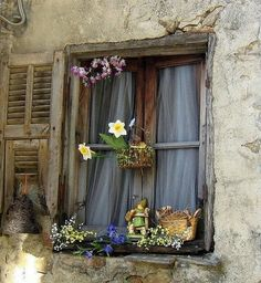 """Find old windows and mount across to look like there are openings into that side of the house. Fix curtains behind them, and do shutters. Goes with the """"entry as courtyard idea. Window View, Open Window, Rear Window, Window Dressings, Lounge Decor, Through The Window, Old Doors, Window Boxes, Window Shutters"""