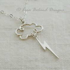 Storm Cloud Pendant by Lisa Boland Designs - A sizzling little lightening bolt dangles from a sweet puffy cloud, all in sterling silver with an 18 inch chain. Pendant is approximately 1 and 3/4 inches long from the top of the cloud to the tip of the lightening bolt, 3/4 inch wide.