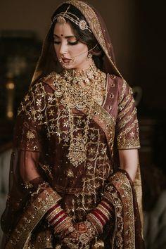 This bride's fusion of Sikh and Rajasthani bridal look is stunning while it's unique colour lehenga gives us major inspiration.   #bridaljewellery #indianjewellery #mathapatti #indianwedding #shaadisaga #Maangtikkas #bridaljhumar #goldjewellery #pearljewellery #nath #ranihaar #choker #borlamathapatti #redlehenga #royalIndiajewellery #uniquecolourlehenga #sikhwedding #rajasthaniwedding  Indian Bridal Outfits, Indian Bridal Fashion, Pakistani Bridal Wear, Indian Bridal Lehenga, Bridal Dresses, Punjabi Wedding, Indian Wedding Dresses, Indian Wedding Makeup, Pakistani Dresses
