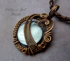 Wire Wrapped jewelry handmade, silver mother of pearl and copper wire wrapped pendant by PillarOfSaltStudio, $40.00