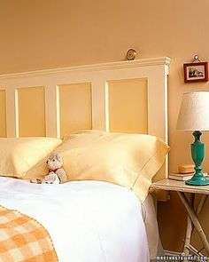Love these headboards made out of old doors...add a piece of trim and a bit of color.