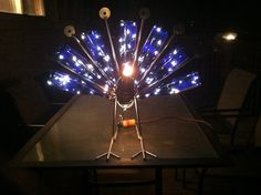 how to make a peacock from wine bottles | peacock wine bottle holder with lights - Project Photos - Metal Artist ...