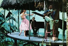 """Dancing in the Tropics. Advertisement illustration.IntercontinentalHotels, Mexico City, 1959. """"Roughing it with all the comforts of home."""""""