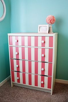 Formerly The World's Ugliest Dresser, bought at a yard sale for 10 bucks-- now fabulous pink striped dresser for my little girl!  Tutorial on my blog.
