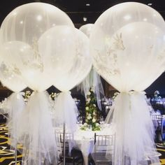 LOVE these giant-3ft white balloons wrapped in glamorous tulle fabric. Brilliant idea via #balloons.net
