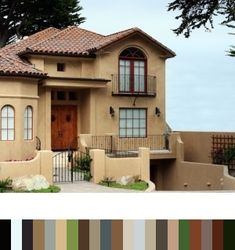 Contemporary adobe house, love the Spanish tile and well, everything!